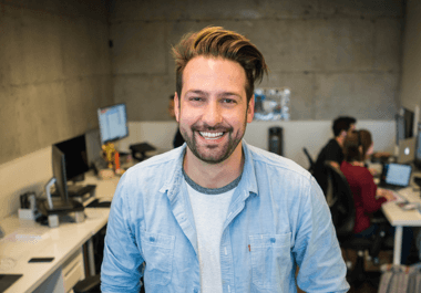 Smiling man keeping his audience engaged during an online event